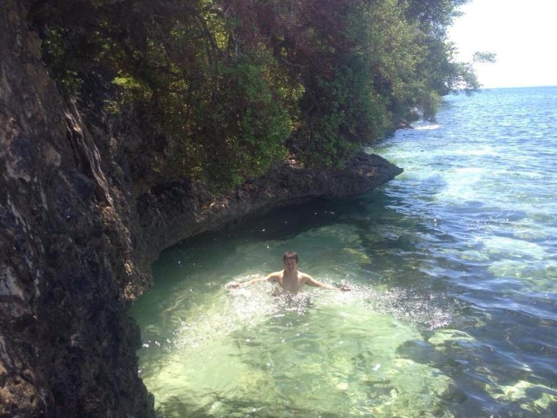 One of our guests taking a dip on our little beach. Note the clear water. Good for snorkeling.