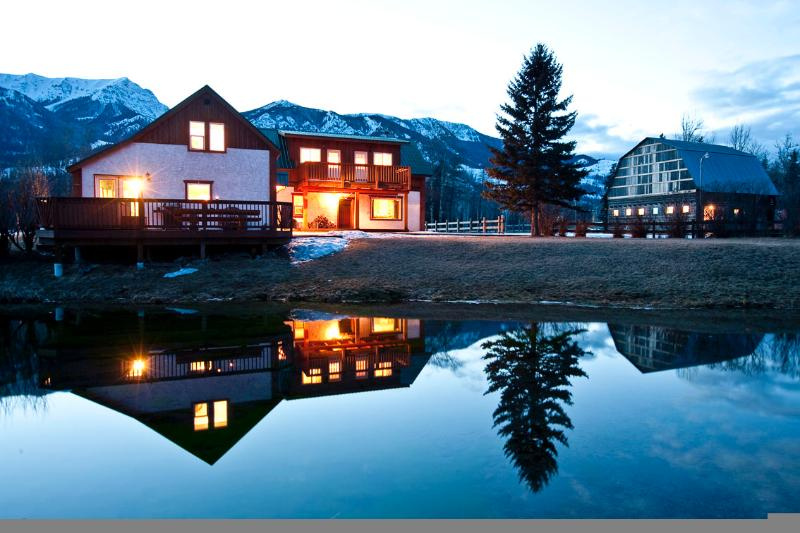 Elk River Lodge with spring creek, elk river flowing by and mountains all around.