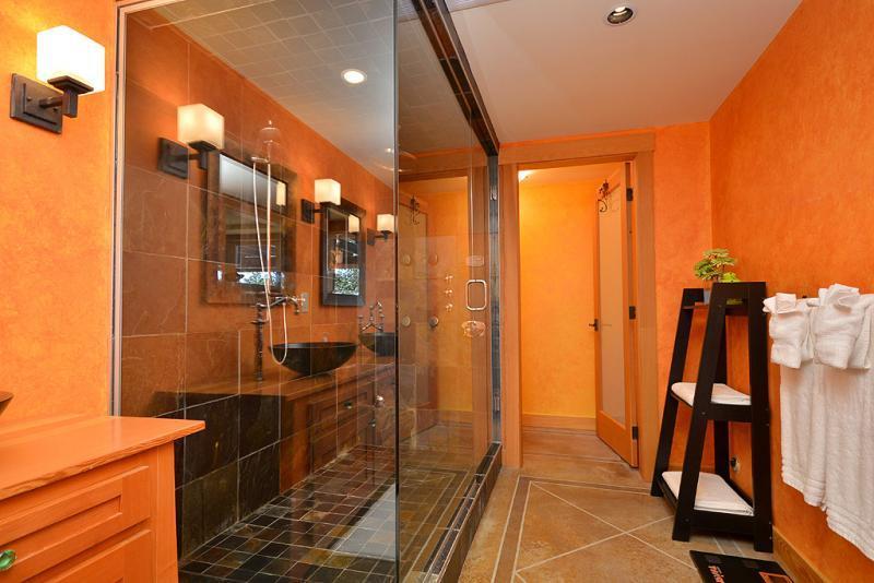 Multiple shower heads in the luxurious walk in shower