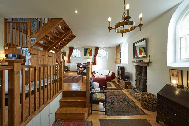 The open-plan living space downstairs compliments a holiday atmosphere.