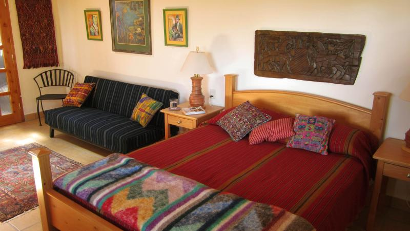 This apartment features beautiful & colorful Guatemalan fabrics and handmade furniture.