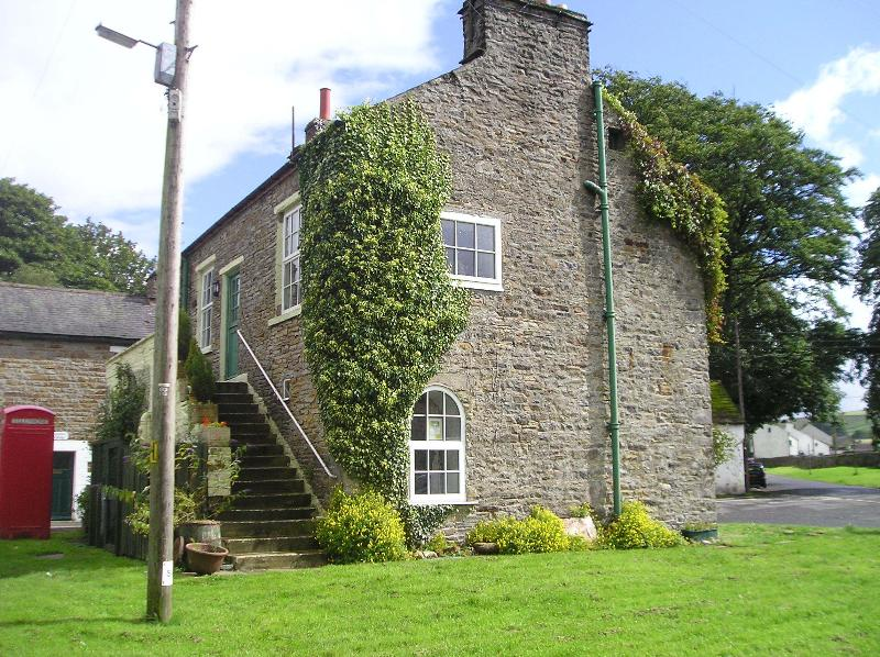 The view of the house from the village green