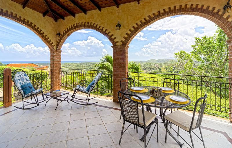 The terrace has a second table for four and outdoor furniture.
