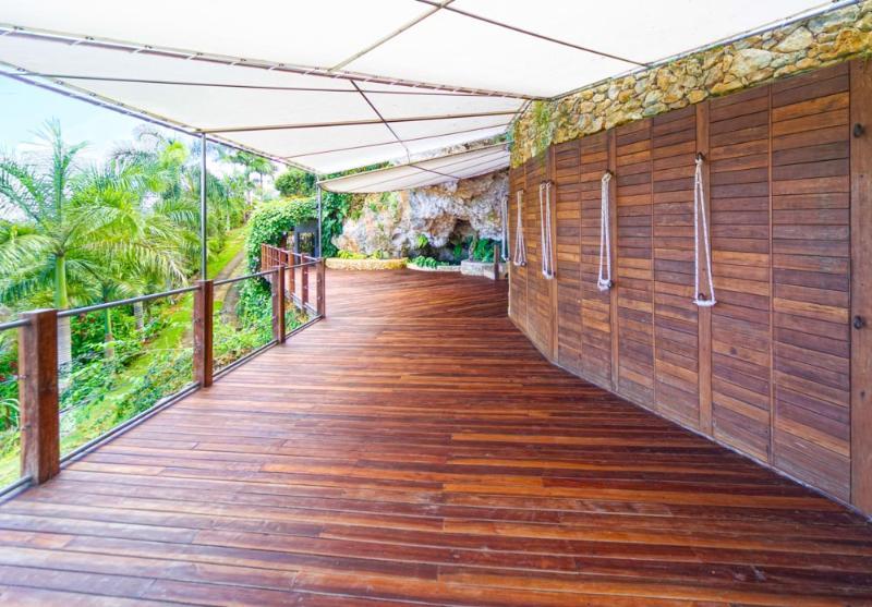 Large wooden deck and Iyengar rope wall.