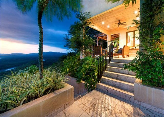 Stairs from pool deck to dining terrace