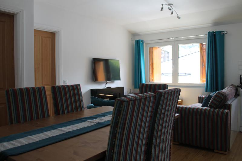 Living and Dining area, wooden floors and new oak doors which can be locked.