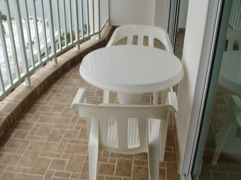 Table & Chairs on Balcony with Beach View