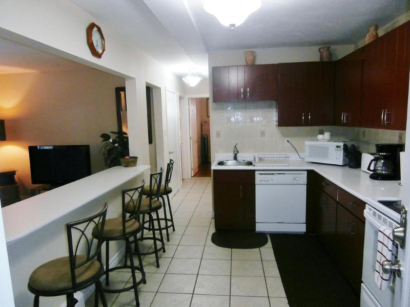 Suite 2. Fully Equipped Open Concept Kitchen/Breakfast Bar with Swivel Matching Counter Top Stools.
