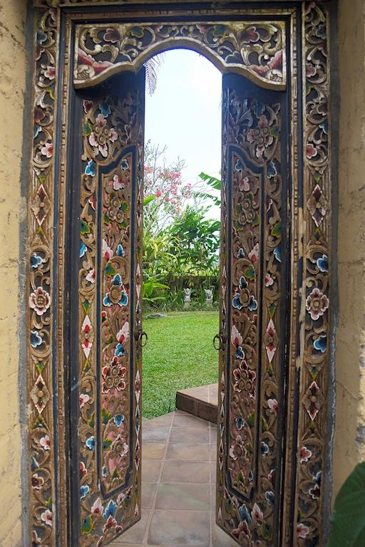 Balinese carved Entrance gates to large private garden and apartment.