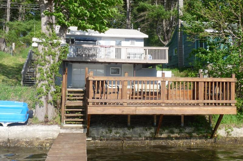 view of cottage from end of dock
