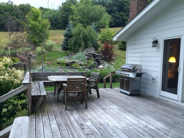 Back deck off the den view to waterfall and koi pong