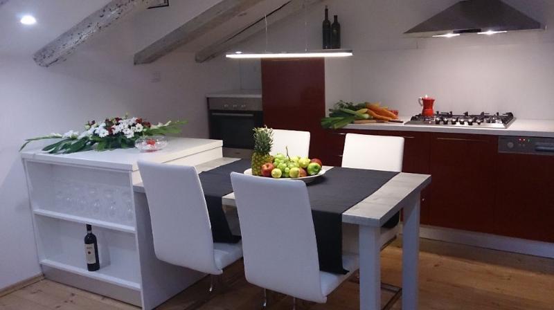 Kitchen. Please note my loving tribute to Italian espresso machine, La Moca, but in red and white co