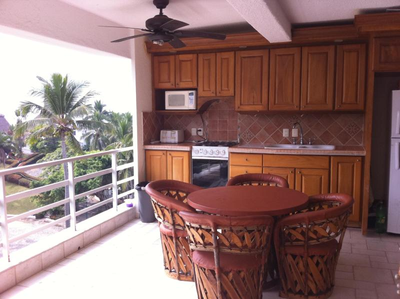 Kitchen is located on the deck.