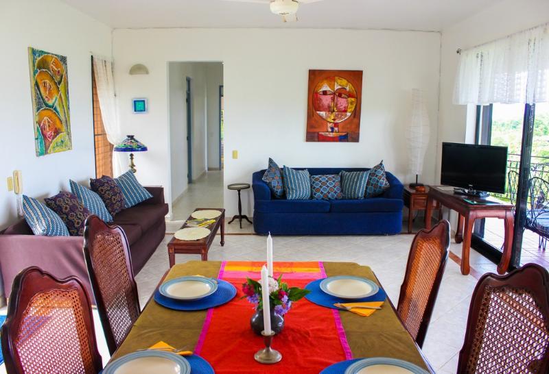 Living area has a sofa sleeper and is open to the terrace with ocean view.