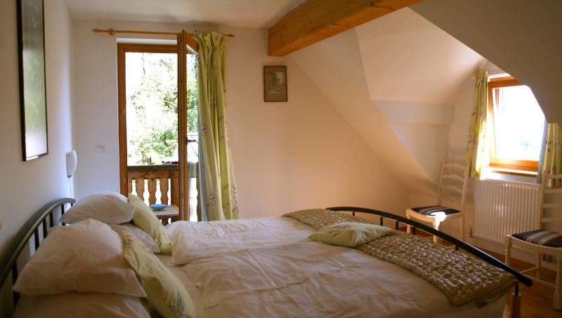 The double bedroom; full sized king bed & with it's own balcony.