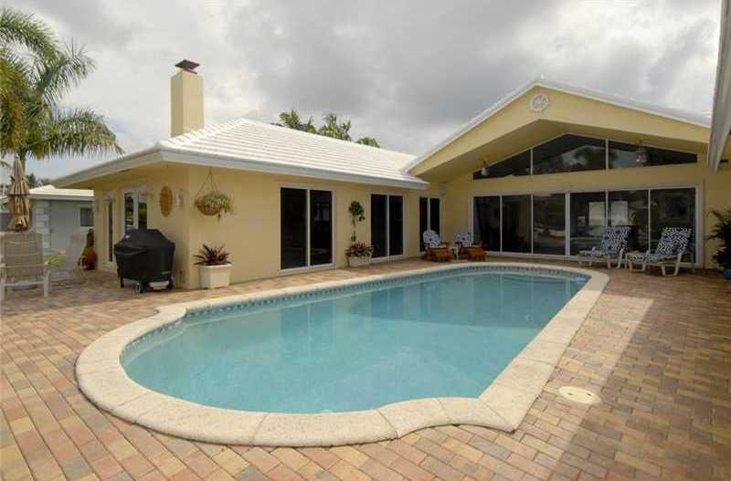 Private pool and patio with gas grill, speakers, and views of the boats and canal.