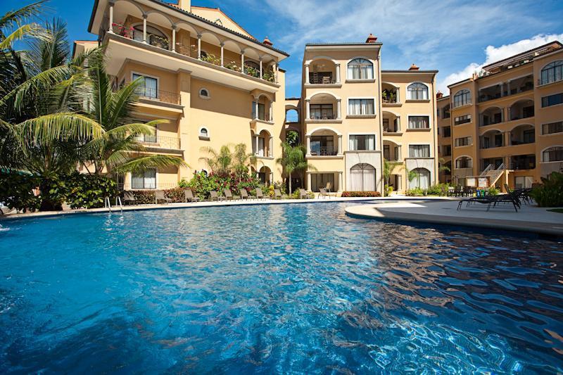 Sunrise resort style pool with waterfall