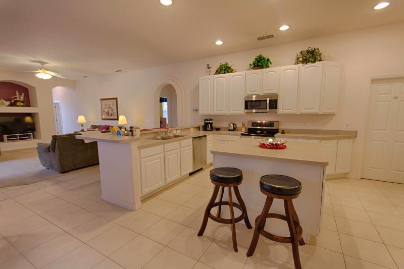 Very large open plan kitchen with breakfast bar.