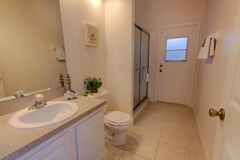 Bathroom for bedroom 2 and access to the pool deck.