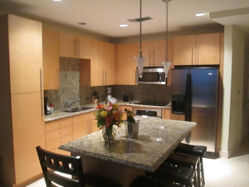 Chef's delight! Stainless steel appliances, granite counter tops