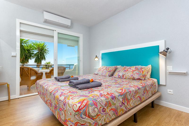 Master bedroom with air con and views of the med