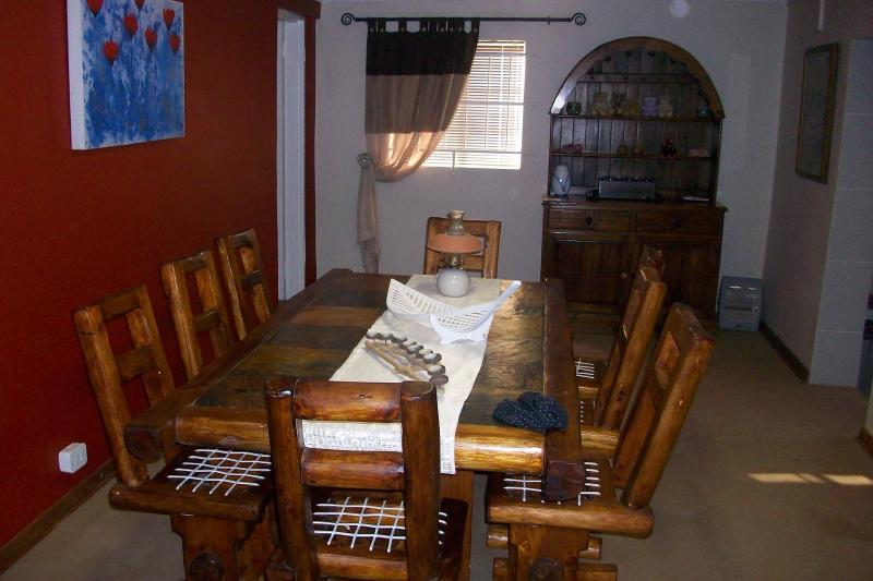 Dining room with table and eight chairs