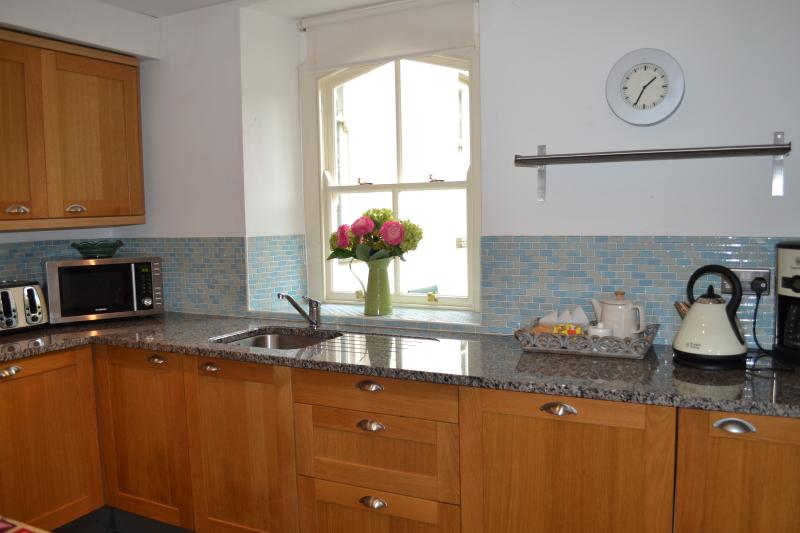 Modern fitted kitchen with granite worktops.
