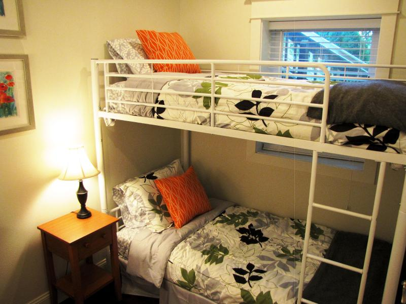 A second bedroom is located upstairs off the entry.