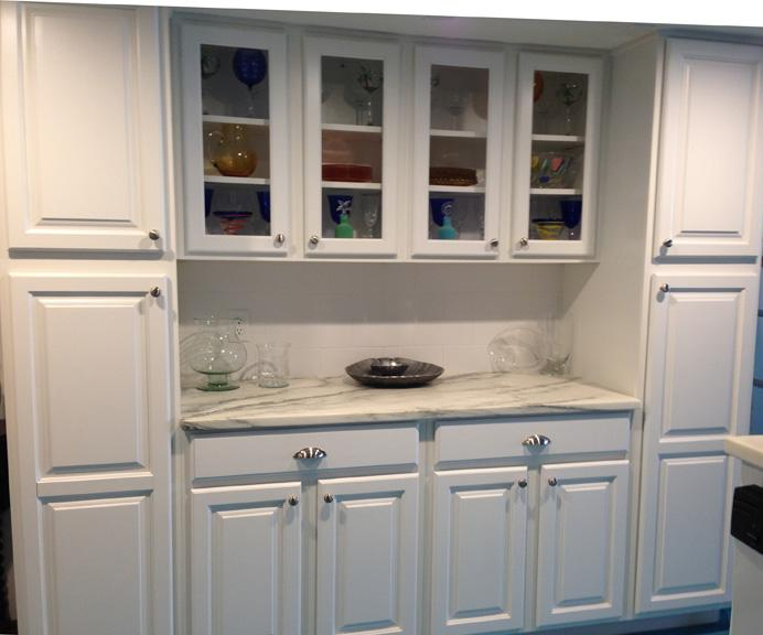 Built in China Cabinet and pantries. We leave the pantries and lower storage empty for you to fill.