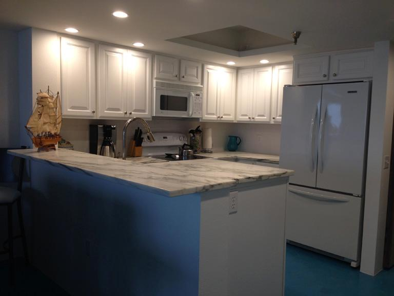 Brand new open kitchen with gorgeous marble countertops.