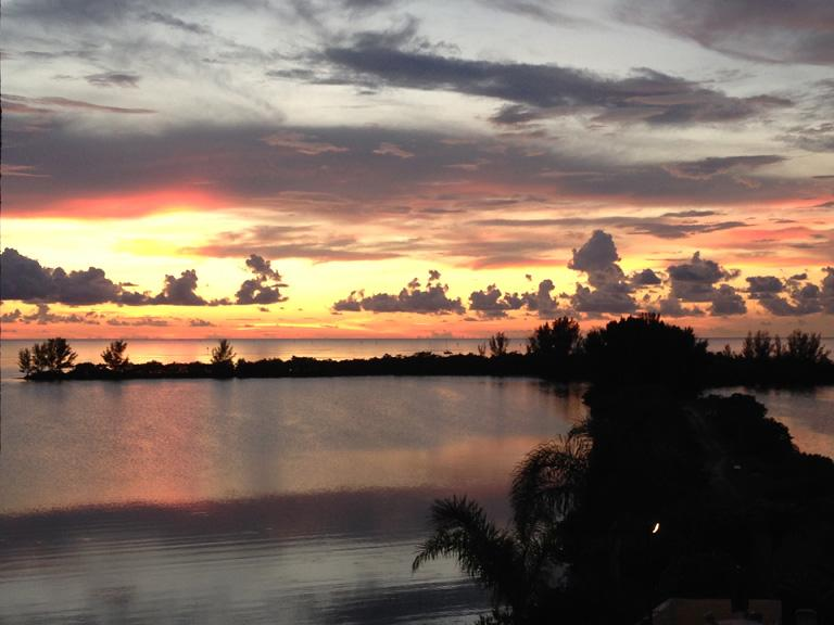 Sunset over the lagoon. We are blessed to see both sunrise and sunset from our balcony.