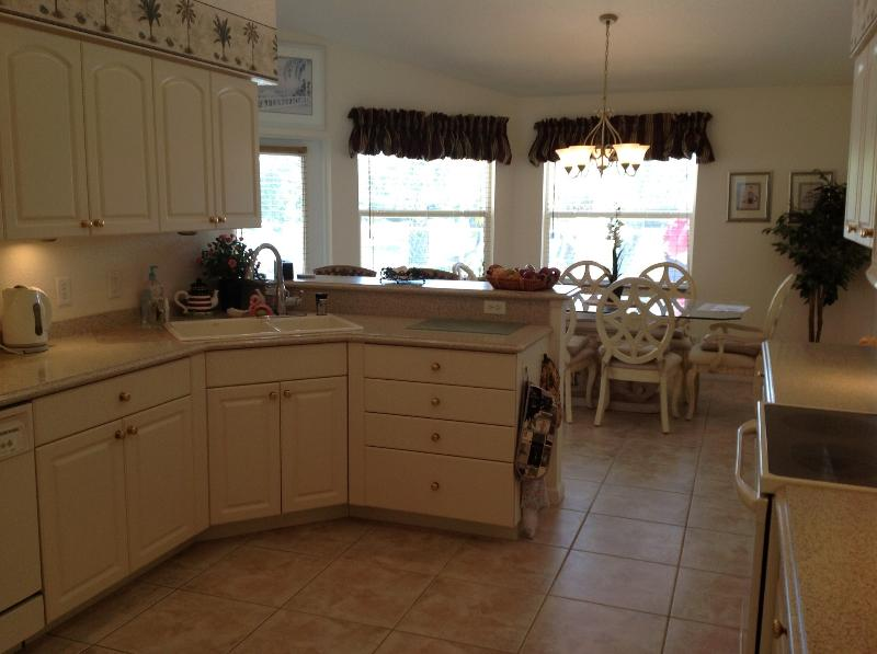 Opposite view of the kitchen with the dining table for 6 in the background