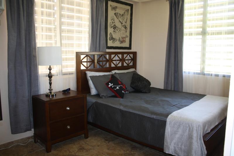Studio Apartment bedroom with Queen size bed, TV & A/C