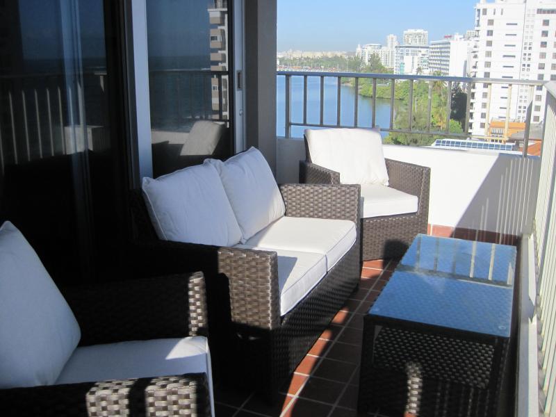 Balcony furniture with lagoon.