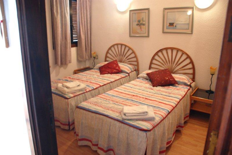 Main bedroom with ensuite facilities including shower, vanity unit, hand basin & toilet.
