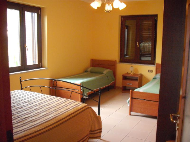 room with 4 beds apartment n 3 on the first floor