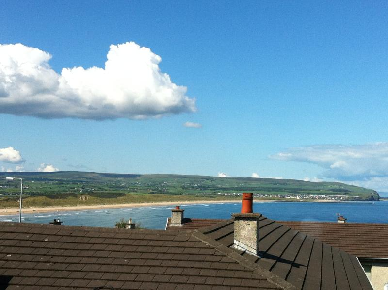 View from upstairs lounge of Portsetwart Strand, Castlerock and Donegal