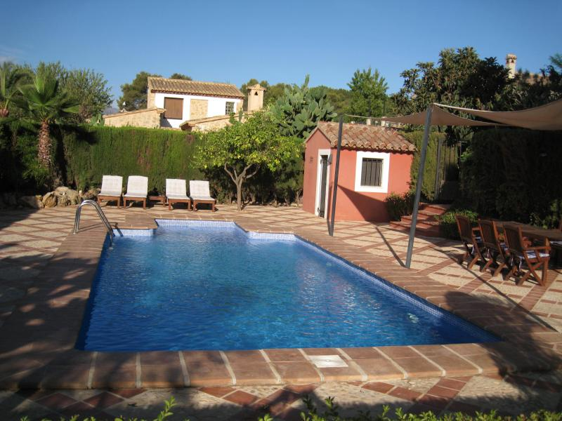 Swimming pool, deck and gazebo 1 next to pool.