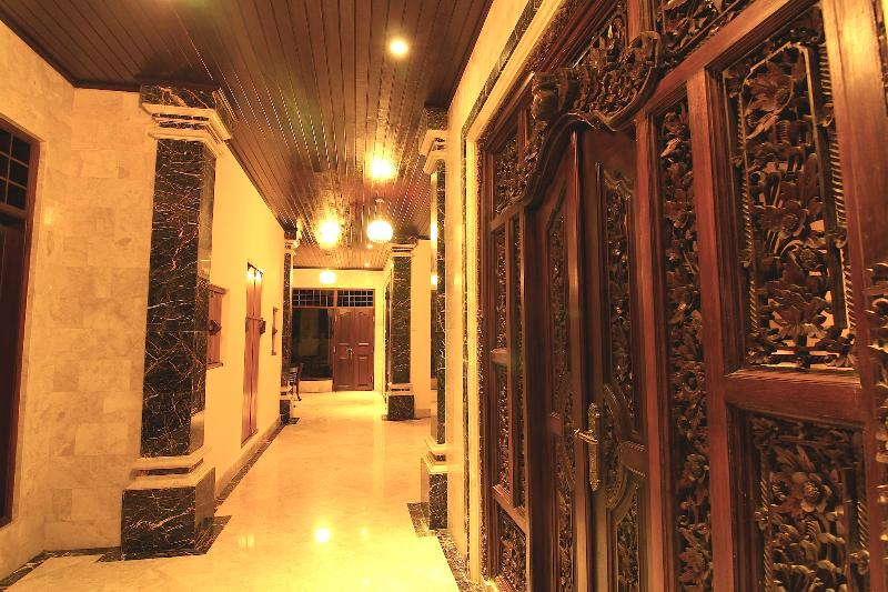 Marble Flooring And Intricately Carved Bedroom Doors