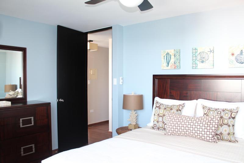 Comfortable queen bedroom.