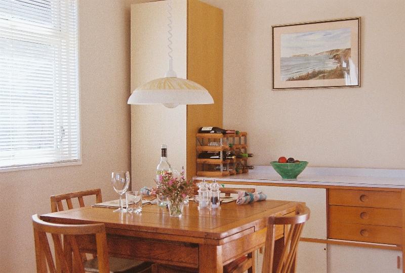 Light dining area next to kitchen