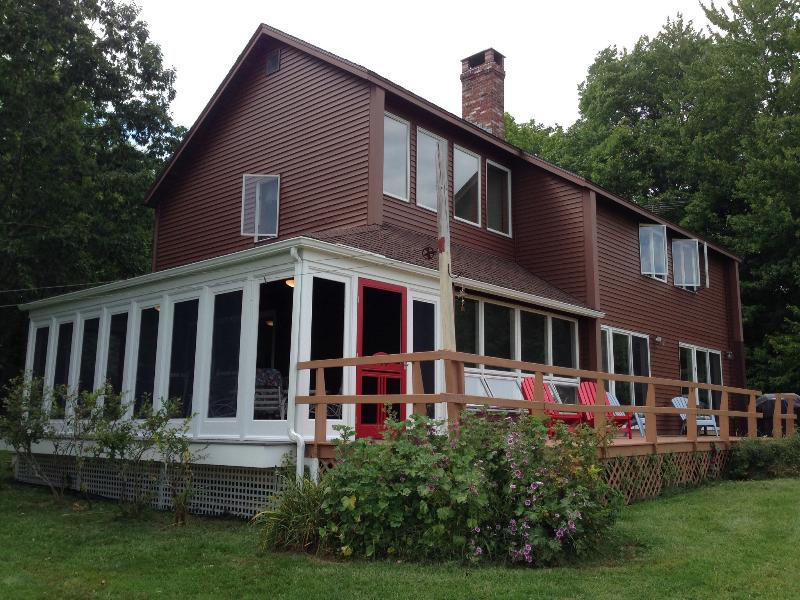 The Fort Point Cove Cottage wrap around deck