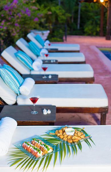 Around dusk, the butler serves hors d'oeuvres on the verandah or pool terrace ...