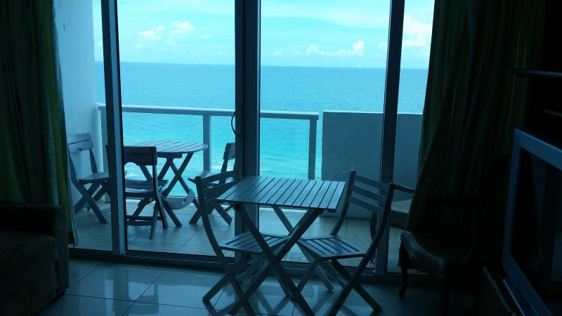 Balcony facing ocean and beach