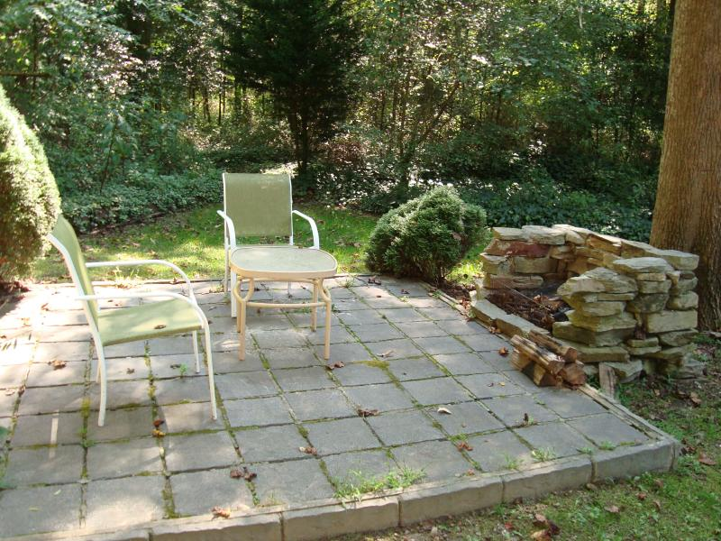 Delightful Fire Pit in the back yard. There also is an outdoor gas grill for your use.