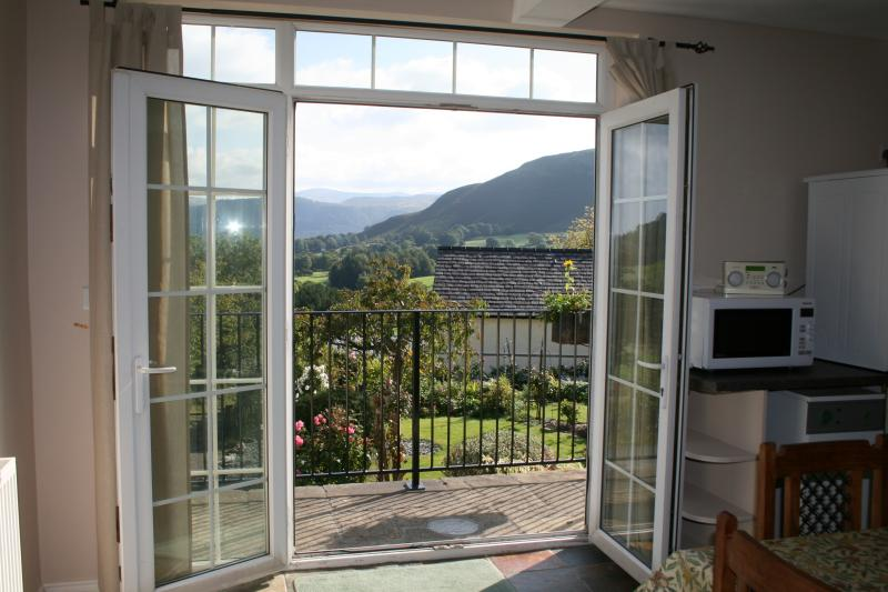 The large, well equipped kitchen with doors onto the balcony, views of Skiddaw and Catbells.