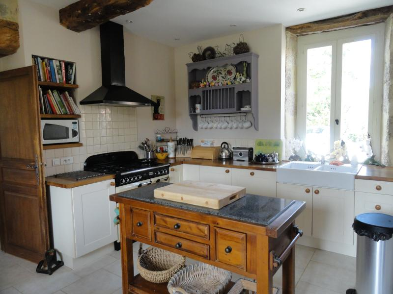 Light and airy kitchen with range cooker and American fridge freezer,