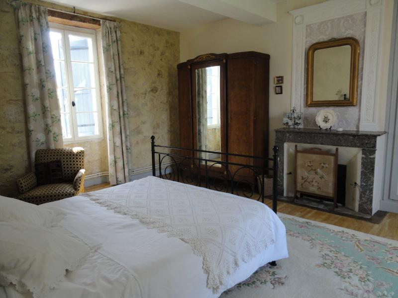 Master bedroom with lovely views over the garden and pool