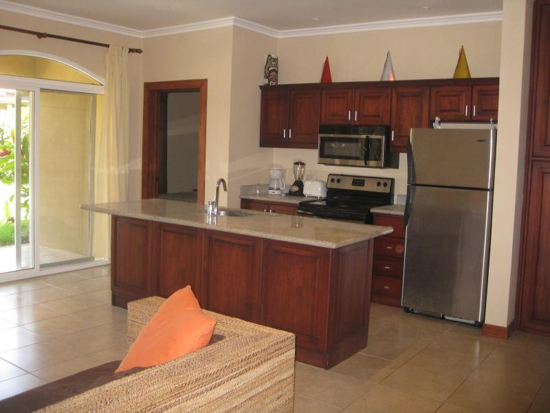 Large kitchen with stainless steel appliances (including dishwasher) and granite countertops