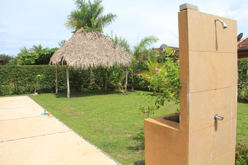 Outdoor shower and rancho with palm leaves